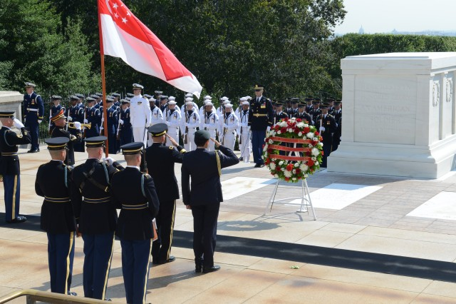 (Left to right) Maj. Gen. Jeffrey S. Buchanan, Joint Force Headquarters-National Capital Region/U.S. Army Military District of Washington commanding general and Lt. Gen. Ng Chee Meng, Chief of Defense Force, Singapore Armed Forces render honors during an Armed Forces Full Honors Wreath Laying ceremony at the Tomb of the Unknown Soldier in Arlington National Cemetery, Va., Aug. 21, 2014.