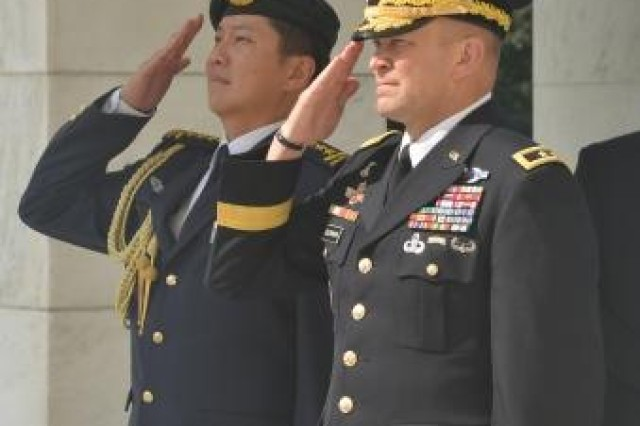 (Left to right) Lt. Gen. Ng Chee Meng, Chief of Defense Force, Singapore Armed Forces and Maj. Gen. Jeffrey S. Buchanan, Joint Force Headquarters-National Capital Region/U.S. Army Military District of Washington commanding general render honors prior to an Armed Forces Full Honors Wreath Laying ceremony at the Tomb of the Unknown Soldier in Arlington National Cemetery, Va., Aug. 21, 2014.