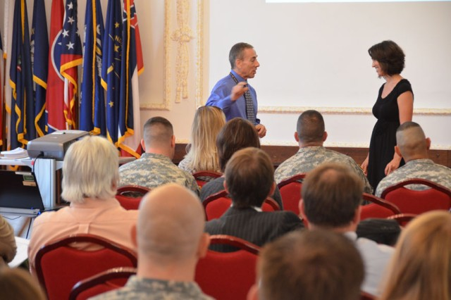 "Tony Garcia, the program manager at Wiesbaden, Germany, for Comprehensive Soldier and Family Fitness, and Heidi Nemec, the primary instructor for CSF2, teach active constructive responding during the CSF2 Executive Resilience and Performance Course. The four-hour course taught U.S. Army Garrison Ansbach Soldiers, civilians and spouses life skills in modules such as ""Hunt the Good Stuff,"" goal setting and active constructive responding at USAG Ansbach's Von Steuben Community Center, Germany, Aug. 18, 2014."
