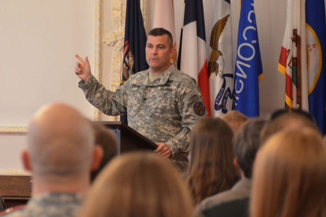 "Col. Christopher M. Benson, U.S. Army Garrison Ansbach commander, introduces the Comprehensive Soldier and Family Fitness mobile training team that will deliver the CSF2 Executive Resilience and Performance Course. The four-hour course taught garrison Soldiers, civilians and spouses life skills in modules such as ""Hunt the Good Stuff,"" goal setting and active constructive responding at the Von Steuben Community Center, Germany, Aug. 18, 2014."