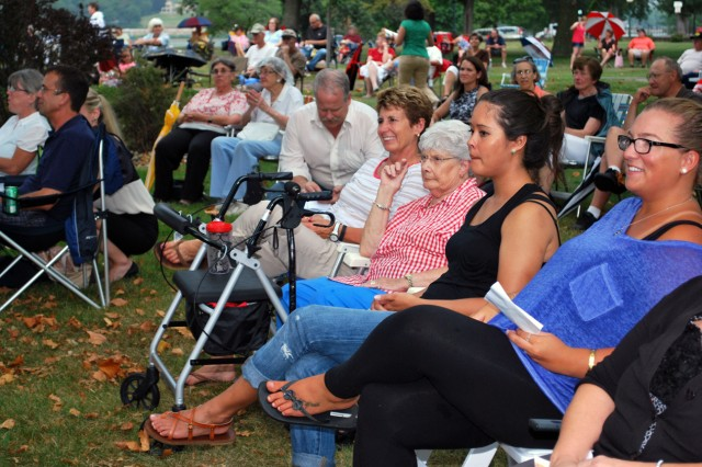 Community members gather on the lawn of Quarters One at Rock Island Arsenal, Ill., as they listen to the U.S. Army Materiel Command Band perform in honor of the 50th Anniversary of the Vietnam War, Aug. 21. (Photo by Dawn Marie Barnett, ASC Public Affairs)
