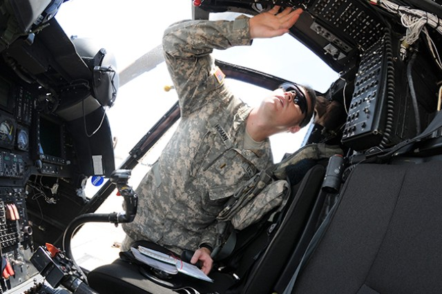 Second Lt. Larry Homan, OH-58D student pilot, performs preflight checks before taking the helm of an OH-58D Kiowa Warrior at Hanchey Army Heliport, Aug. 18, 2014, at Fort Rucker, Ala. Homan is part of the last OH-58D class at Fort Rucker.