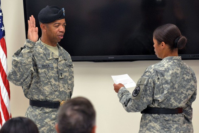 Maj. Gen. A.C. Roper, left, recites the officer's oath during his promotion ceremony officiated by Maj. Gen. Marcia Anderson, Deputy Chief of the Army Reserve, at the Quartermaster Museum located on Fort Lee, Va., Aug. 23, 2014. Roper assumed command of the 80th Training Command (TASS) later in the day in a change of command ceremony also officiated by Anderson.