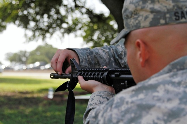 "Soldiers assigned to Battery A, 1st Battalion ""Dragon,"" 82nd Field Artillery Regiment, 1st Brigade Combat Team ""Ironhorse,"" 1st Cavalry Division, practice ""dime and washer"" drills during First Team Training, Aug. 21, at Fort Hood, Texas. During FTT, Dragon Soldiers rotated through four preliminary marksmanship instruction stations, including a station focusing on the four fundamentals of marksmanship. (U.S. Army photo by Spc. Paige Behringer, 1BCT PAO, 1st Cav. Div.)"