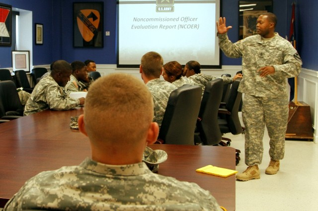 "Sgt. 1st Class Marcus Dixon, a Denton, Texas, native and human resource specialist assigned to Headquarters and Headquarters Company ""Hammer,"" 1st Brigade Combat Team ""Ironhorse,"" 1st Cavalry Division, teaches a class to human resource specialists across the Ironhorse Brigade during First Team Training, Aug. 21, at Fort Hood, Texas. Throughout the day, Soldiers participated in a variety of training activities with afternoon hours set aside for face-to-face time for leaders to counsel Soldiers. (U.S. Army photo by Spc. Paige Behringer, 1BCT PAO, 1st Cav. Div.)"