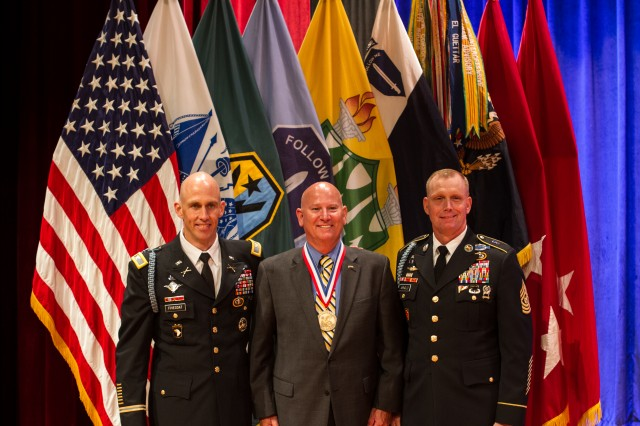 Retired Command Sgt. Maj. Jeffrey Greer, center, is inducted into the Ranger Hall of Fame during a ceremony at Fort Benning, Ga., in July. Congratulating Greer are Col. David Fivecoat, left, and Command Sgt. Maj. Curtis Arnold, the commander and command sergeant major, respectively, of the Airborne and Ranger Training Brigade. Since 1992, the Ranger Hall of Fame has recognized the contributions of America's Soldiers.
