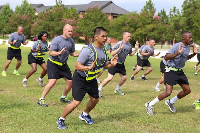 Soldiers in the Master Fitness Trainer Course take part in a group workout.