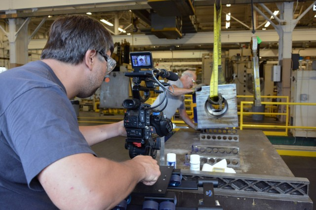 Director of Photography Aaron Szimanski capturing senior machinist Frank Taylor as he readies a 120mm tank breech ring for one of its first manufacturing operations.