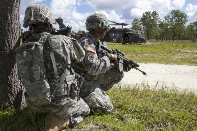 Army Reserve Spc. Michael Edwards provides security while Soldiers load a casualty onto an awaiting UH-60M during a medical evacuation exercise while participating in an urban training event at Camp Blanding, Fla., located near Jacksonville, Fla. Edwards, an infantryman, assigned to the 810th Military Police Company, is from Wesley Chapel, Fla. The Soldiers are assigned to the 724th Military Police Battalion, based at Fort Lauderdale, Fla. Soldiers assigned to 724th spent the day training with the Florida Army National Guard helicopter crews on movement and medical evacuation techniques during their annual training. The 724th is assigned to Fort Meade, Md.-based 200th Military Police Command, which commands more than 13,000 Soldiers living in 44 states. The 200th MPCOM is the Department of Defense's largest law enforcement organization.