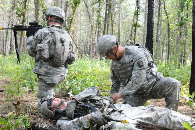 Sgt. Elilberto Ramos provides first aid to a simulated casualty in the warrior task training event during the U.S. Army Forces Command 2014 NCO/Soldier Best Warrior competition, Aug 25, 2014 at Fort Bragg, N.C.