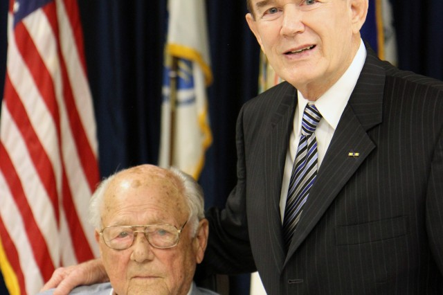"Paul R. Hallman Sr. poses with retired North Carolina State Senator, Bob Atwater during a ceremony in Hallman's honor. The ceremony held at the 108th Training Command (IET) Headquarters in Charlotte, N.C., Aug. 16, 2014 was one day shy of the 70th Anniversary of Hallman's 43rd combat flight during World War II. On that flight, Hallman, who served as an engineer on a B24J ""Liberator"", and his crew were shot down while performing a bombing mission over a Ploesti, Romania oil Refinery. Hallman and several other survivors of the flight were captured by German forces and held in Romania for several months until they were liberated by the Russian Army and returned to American Forces later that year."