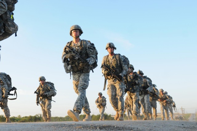 """Platoon leaders and platoon sergeants with 1st Squadron, 9th Cavalry Regiment """"Headhunters,"""" 2nd Brigade Combat Team, 1st Cavalry Division conduct a two-mile road march during the Headhunter leadership challenge, at Fort Hood, Texas, Aug. 15, 2014.  The day-long competition was comprised of several events designed to build platoon leader-platoon sergeant relationships, and engage in healthy competition."""