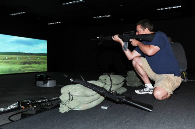 "The ""Engagement Skills Trainer Challenge"" was held on Aug. 23 at Sagami General Depot in which participants competed against one another by shooting at targets on an electronic range with a simulated M16 rifle. (U.S. Army photo by Noriko Kudo)"