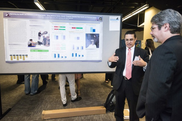 L. Omar Rivera, U.S. Army Public Health Command Public Health Assessment Program, discusses how Army Wellness Centers help clients achieve their health and wellness goals during a poster session at the 3rd International Congress on Soldiers Physical Performance held in Boston.