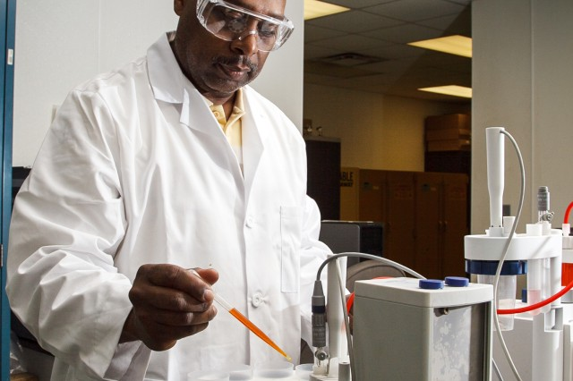 Chemist Stanley Wilson tests samples from Anniston Army Depot's vats in the installation's Chemical Lab.