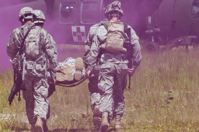 Army Reserve Soldiers carry a casualty to an awaiting UH-60M during a  medical evacuation exercise while participating in an urban training event at Camp Blanding, Florida, located near Jacksonville.  The Army Reserve Soldiers are assigned to the 724th Military Police Battalion, based at Fort Lauderdale, Florida. The Soldiers spent the day training with the Guard's C Company, 1st Battalion, 111th Aviation Regiment (Air Ambulance) from nearby Jacksonville, Florida, on movement and medical evacuation techniques. The 724th is assigned to Fort Meade, Maryland-based 200th Military Police Command which commands more than 13,000 Soldiers living in 44 states. The 200th MPCOM is the largest Department of Defense's largest law