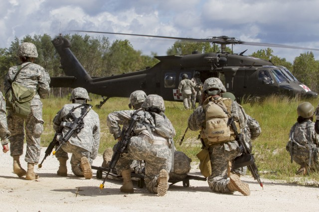 Army Reserve Soldiers prepare to carry a casualty to an awaiting UH-60M during a  medical evacuation exercise while participating in an urban training event at Camp Blanding, Florida, located near Jacksonville.  The Soldiers are assigned to the 724th Military Police Battalion, based at Fort Lauderdale, Florida. Soldiers assigned to 724th spent the day training with the Florida Army National Guard helicopter crews on movement and medical evacuation techniques during their annual training. The 724th is assigned to Fort Meade, Maryland-based 200th Military Police Command which commands more than 13,000 Soldiers living in 44 states. The 200th MPCOM is the largest Department of Defense's largest law enforcement organization. (Army Reserve Photo by Sgt. 1st Class Mark Bell/Released)