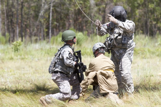 An Army Reserve Soldier and Florida Army National Master Sgt. Wigueroa Figueroa, right, prepares to hoist a civilian up to a UH-60M during a medical evacuation exercise while participating in an urban training event at Camp Blanding, Florida, located near Jacksonville.  The Army Reserve Soldiers are assigned to the 724th Military Police Battalion, based at Fort Lauderdale, Florida. The Soldiers spent the day training with the Guard's C Company, 1st Battalion, 111th Aviation Regiment (Air Ambulance) from nearby Jacksonville, Florida, on movement and medical evacuation techniques. The 724th is assigned to Fort Meade, Maryland-based 200th Military Police Command which commands more than 13,000 Soldiers living in 44 states. The 200th MPCOM is the largest Department of Defense's largest law enforcement organization. (Army Reserve Photo by Sgt. 1st Class Mark Bell/Released)