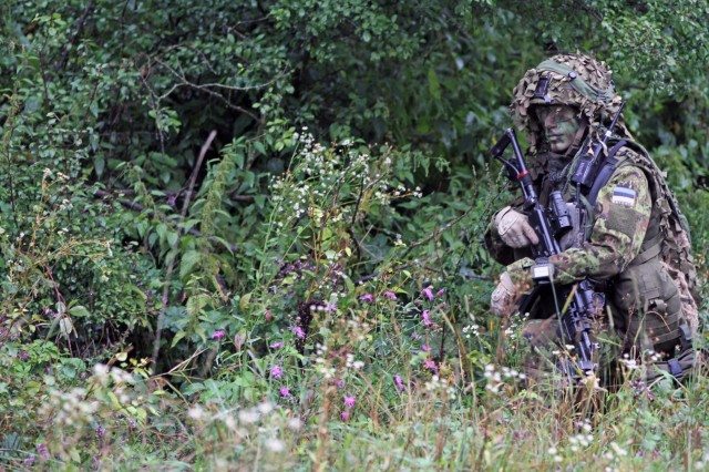 Estonian army Sgt. 1st Class Andrei Kurotskin of Palkiski, and assigned to the Estonia Scout Battalion, provides security during an STX (simulated training exercise) lane at Hohenfels Training Area, Germany, Aug. 27, 2014. Saber Junction 14 is a large-scale, joint, multinational, annual military exercise, involving hundreds of aircraft and vehicles and thousands of personnel from 16 different nations. The exercise will prepare brigade-level units for worldwide contingency operations.  The exercise further focuses U.S., NATO, and partner forces on concepts such as decisive and sustainable land operations through the simultaneous combination of offensive, defensive and stability operations and on interoperability with partnered nations.