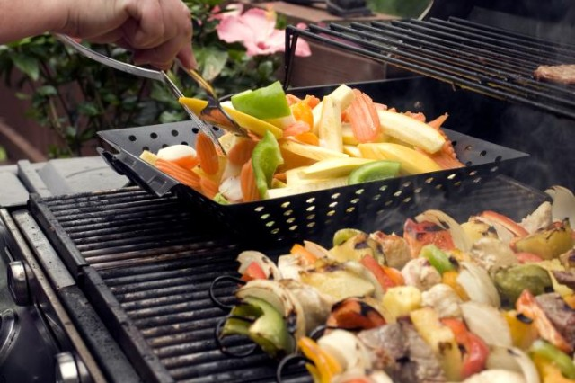 In this stock photo from the Centers for Disease Control and Prevention, shish kebabs are cooked over a grill. During the holiday weekend, safety should be a priority in all activities. (Photo courtesy of Amanda Mills, Centers for Disease Control and Prevention)