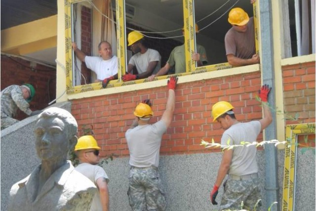 U.S. Army Reserve Soldiers with the 412th Engineer Company, based Scranton, Pa., work alongside Macedonia Soldiers and contractors to renovate the doors and windows of the kindergarten Femo Kulakov in Negotino, Macedonia, Aug. 4-26. (U.S. Army photo by Master Sgt. Darryl Cheatham)