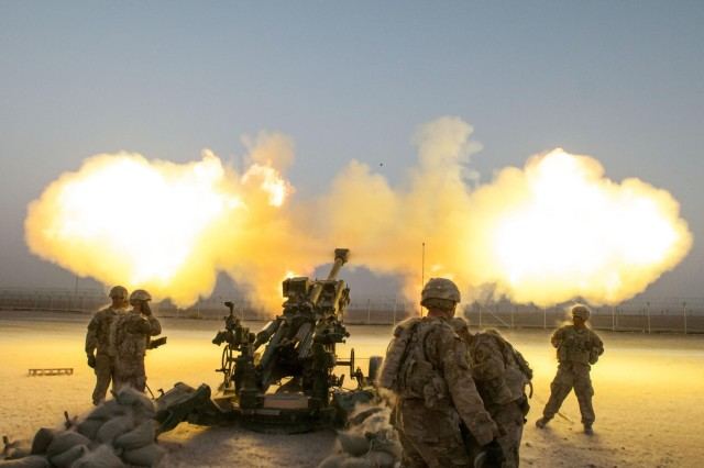 Soldiers serving with Alpha Battery, 2nd Battalion, 77th Field Artillery Regiment, 4th Infantry Brigade Combat Team, 4th Infantry Division, shoot a round down range from their M777A2 howitzer on Kandahar Airfield, Afghanistan, Aug. 22, 2014. The round was part of a shoot to register, or zero, the howitzers, which had just arrived on Kandahar Airfield from Forward Operating Base Pasab. The shoot also provided training for a fire support team from 1st Battalion, 12th Infantry Regiment, 4th Infantry Brigade Combat Team, 4th Infantry Division.