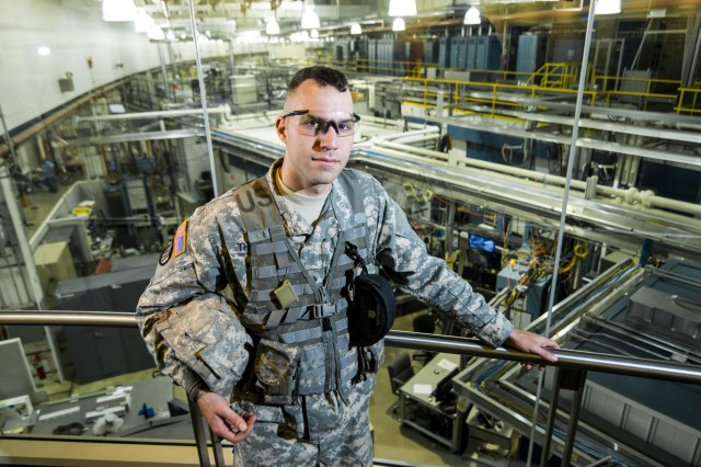 Spc. Kevin Thomas, Soldier with the 863rd Engineer Battalion, poses on the mezzanine level of the Advance Photon Source building of the Argonne National Laboratory in Darien, Ill., as part of a photo shoot that promotes Citizen-Soldiers in the science, technology, engineering and math industries. (U.S. Army illustration by Sgt. 1st Class Michel Sauret)