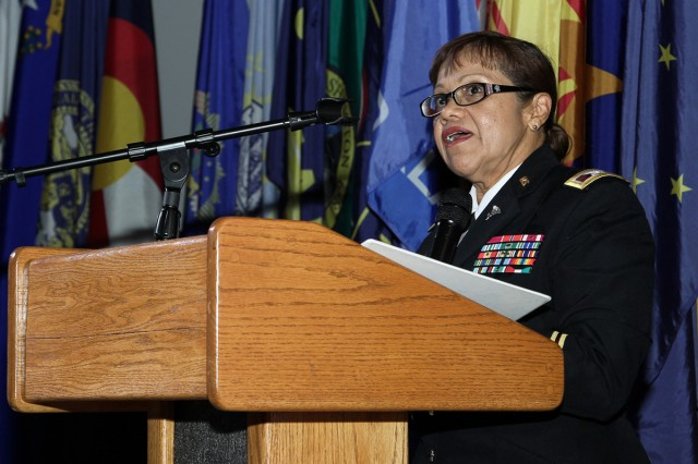 """Col. Thirsa Martinez, commander of the U.S. Army Medical Department Activity-Japan, talks about how women advance in today's society at the """"Women's Equality Day"""" observance held on Aug. 26 at the Camp Zama Community Activity Center."""