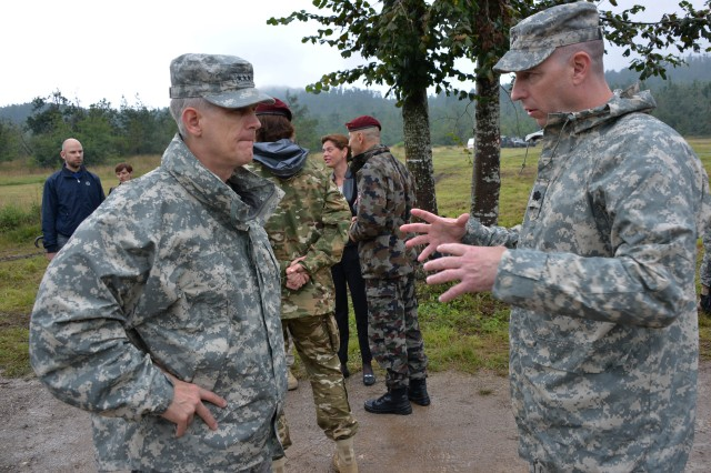 Lt. Col. Jeff Cantor, an exercise Immediate Response 14 director -- Vipava with the 353rd Civil Affairs Command, briefs Lt. Gen. Donald M. Campbell Jr., commanding general of U.S. Army Europe, on the scenario demonstration during IR-14 for distinguished visitor's day at Pocek, Slovenia, Aug. 27, 2014. More than 200 distinguished visitors and dignitaries attended the exercises D/V day.