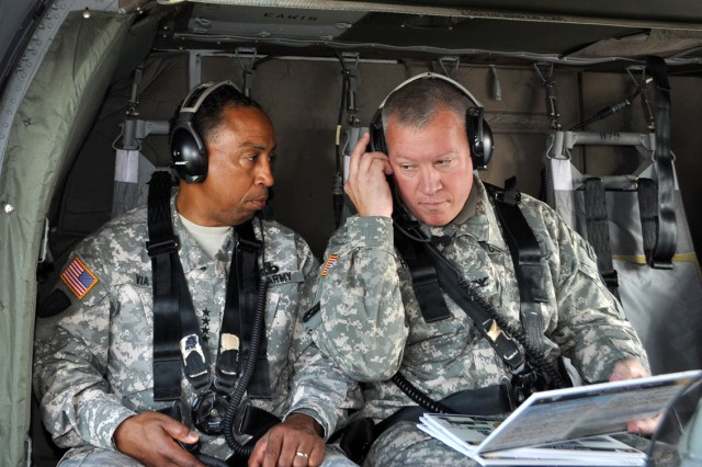 Blue Grass Army Depot Commander, Col. Lee G. Hudson reviews a BGAD brief with Army Materiel Command's Gen. Dennis L. Via during an Aug. 27 visit.