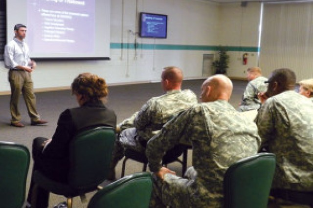 Michael Moore, Ph.D., military sexual trauma coordinator at the Southern Arizona Veterans Affairs Health Care System in Tucson, presents a session on military sexual trauma, or MST, in the Murr Community Center, Aug. 22. Attendees learned about how the VA assists patients with MST and the treatments available to them.