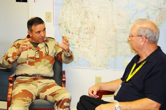 """French Lt. Col. Eric Merck, Fort Rucker French liaison officer, explains his vision of the 12-week French language refresher course to Henry """"Chick"""" Eagle III, supervisory education services specialist at the Fort Rucker Army Education Center."""