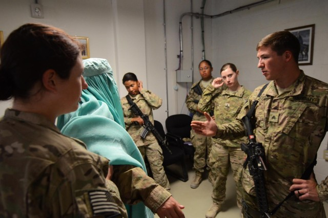 Sgt. Donald Carlisle, a military policeman, gives instruction on searching a detainee during a Female Engagement Team class Aug. 27, 2014, at the Regional Command-South headquarters on Kandahar Airfield, Afghanistan. The two-day class provided Soldiers with training that emphasized Afghan culture and customs, engaging Afghan leadership, and gender-equality issues relating to Afghan women. (U.S. Army photo by Staff Sgt. John Etheridge)