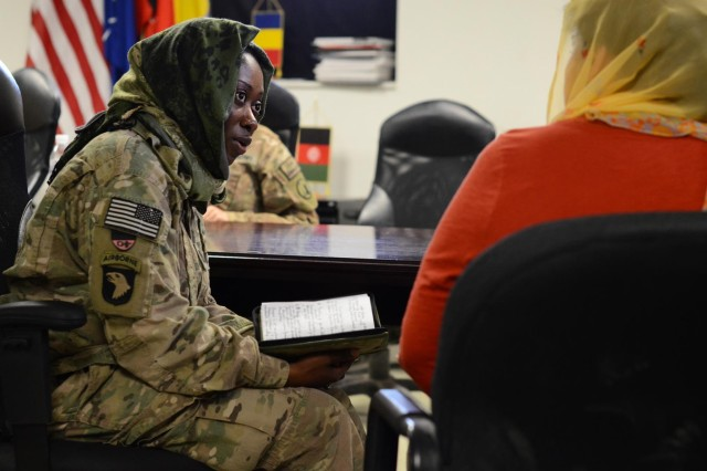 Capt. Eunice Owusu-Boadi speaks with an interpreter while role-playing in an Afghan key leader meeting as part of a Female Engagement Team class Aug. 27, 2014, at the Regional Command-South headquarters on Kandahar Airfield, Afghanistan. The two-day class provided Soldiers with training that emphasized Afghan culture and customs, engaging Afghan leadership, and gender-equality issues relating to Afghan women. (U.S. Army photo by Staff Sgt. John Etheridge)