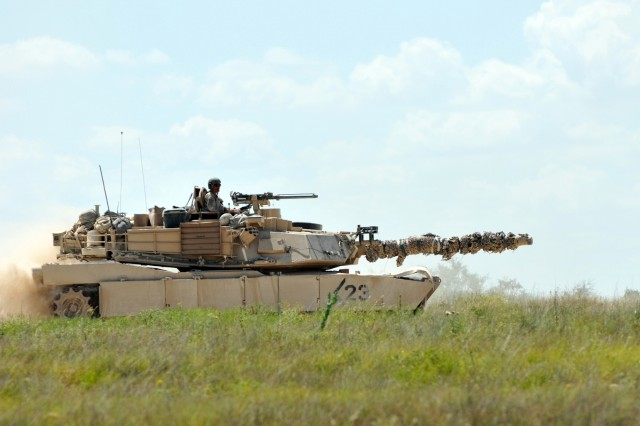 A tank crew with 3rd Battalion, 8th Cavalry Regiment, 3rd Brigade Combat Team, 1st Cavalry Division, maneuvers a M1A2 Abrams tank during a field training exercise July 14, 2014, at Fort Hood, Texas. The 3-8th Cavalry Regt. will conduct a nine-month rotational deployment to South Korea as part of U.S. enduring re-balancing efforts in the Asia-Pacific region. The unit will replace 1st Battalion, 12th Cavalry Regiment, which is currently deployed to South Korea.