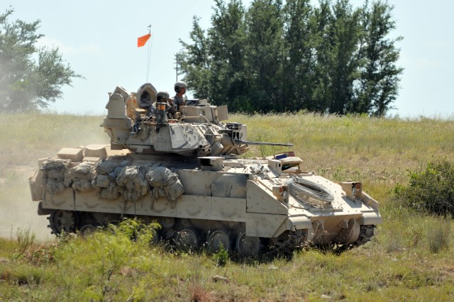 A crew with 3rd Battalion, 8th Cavalry Regiment, 3rd Brigade Combat Team, 1st Cavalry Division, maneuvers a M2A3 Bradley Fighting Vehicle during a training exercise July 13, 2014, at Fort Hood, Texas. The 3-8th Cavalry Regt. will conduct a nine-month rotational deployment to South Korea as part of U.S. enduring re-balancing efforts in the Asia-Pacific region. The unit will replace 1st Battalion, 12th Cavalry Regiment, which is currently deployed to South Korea.