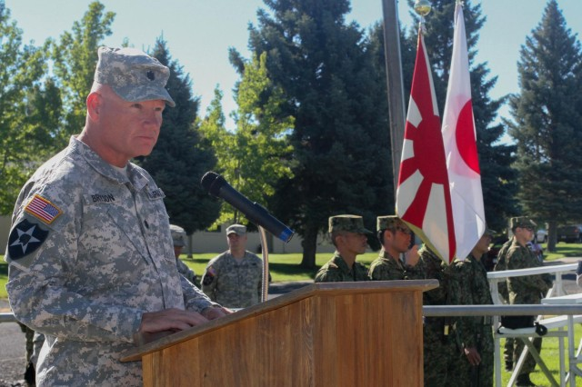 Col. Jeff Bryson, commander of 4th Battalion, 23rd Infantry Regiment, 2-2 Stryker Brigade Combat Team, 7th Infantry Division, Joint Base Lewis-McChord, Wash., addresses his Soldiers and members of the Japan Ground Self-Defense Force, during the opening ceremony for Operation Rising Thunder at Yakima Training Center, Yakima, Wash., Sept. 2, 2014.  Operation Rising Thunder will allow Soldiers to train with the Japan Ground Self-Defense Force to help increase their combined forces experience.