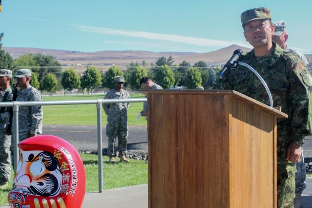 Col. Takashi Goto, a commander with the Japan Ground Self-Defense Force, addresses Soldiers of 4th Battalion, 23rd Infantry Regiment, 2-2 Stryker Brigade Combat Team, 7th Infantry Division, Joint Base Lewis-McChord, Wash., and members of the Japan Ground Self-Defense Force during the opening ceremony for Operation Rising Thunder at Yakima Training Center, Yakima, Wash., Sept. 2, 2014. Operation Rising Thunder allowed Soldiers to train with the Japan Ground Self-Defense Force to help increase their combined forces experience.
