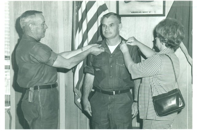 Bennie G. Adkins is promoted to the rank of command sergeant major, with the help of his wife, Mary.