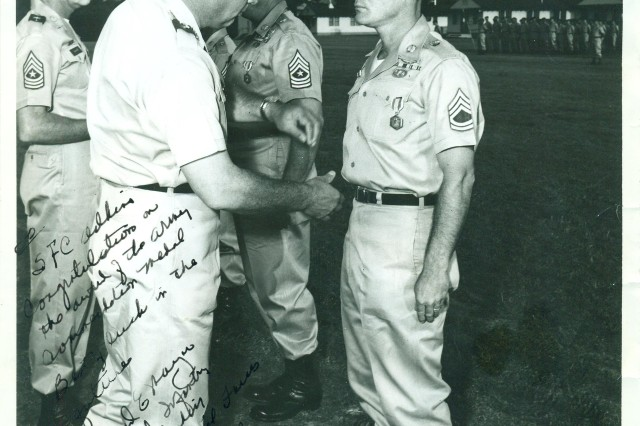 Then-Sgt. 1st Class Bennie G. Adkins receives an Army Commendation Medal from the Commander of the 7th Special Forces Group, in 1964, at Fort Bragg, N.C.