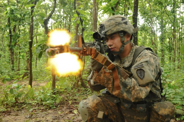 Spc. Kevin Gallardo, an infantryman with Delaware Company, 1st Battalion (Airborne), 501st Infantry Regiment, 4th Infantry Brigade Combat Team (Airborne), 25th Infantry Division, fires his M4 carbine during a tactical training exercise Aug. 26, 2014, at the Rajendrapur Catonement Training Area, near Dhaka, Bangladesh. Gallardo was in Bangladesh for Aurora Monsoon, a bilateral exchange and training exercise focused on building relationships and enhancing abilities in operating in a jungle environment and unfamiliar terrain. (U.S. Army photo by Sgt. 1st Class Jeffrey Smith/Released)