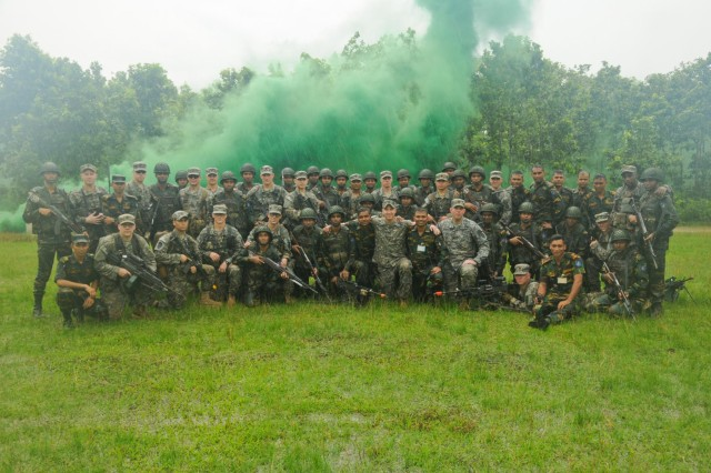 Paratroopers with the 1st Battalion (Airborne), 501st Infantry Regiment, 4th Infantry Brigade Combat Team (Airborne), 25th Infantry Division, and soldiers from the Bangladesh Army's 46th Independent Infantry Brigade take a moment for a group photo Aug. 25, 2014, at the Bangladesh Institute of Peace Support Operation Training at the Rajendrapur Catonement Training Area, near Dhaka, Bangladesh. The U.S. Army was in Bangladesh for Aurora Monsoon, a bilateral exchange and training exercise focused on building relationships and enhancing abilities in operating in a jungle environment and unfamiliar terrain. (U.S. Army photo by Sgt. 1st Class Jeffrey Smith/Released)