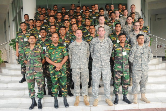 Paratroopers with the 1st Battalion (Airborne), 501st Infantry Regiment, 4th Infantry Brigade Combat Team (Airborne), 25th Infantry Division, and soldiers from the Bangladesh Army's 46th Independent Infantry Brigade take a moment for a group photo Aug. 23, 2014, at the Bangladesh Institute of Peace Support Operation Training at the Rajendrapur Catonement Training Area, near Dhaka, Bangladesh. The U.S. Army was in Bangladesh for Aurora Monsoon, a bilateral exchange and training exercise focused on building relationships and enhancing abilities in operating in a jungle environment and unfamiliar terrain. (U.S. Army photo by Sgt. 1st Class Jeffrey Smith/Released)