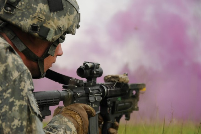 Spc. John Brunner, an infantryman with Delaware Company, 1st Battalion (Airborne), 501st Infantry Regiment, 4th Infantry Brigade Combat Team (Airborne), 25th Infantry Division, maintains security before moving under the concealment of smoke Aug. 26, 2014, at the Rajendrapur Catonement Training Area, near Dhaka, Bangladesh. Brunner was in Bangladesh for Aurora Monsoon, a bilateral exchange and training exercise focused on building relationships and enhancing abilities in operating in a jungle environment and unfamiliar terrain. (U.S. Army photo by Sgt. 1st Class Jeffrey Smith/Released)