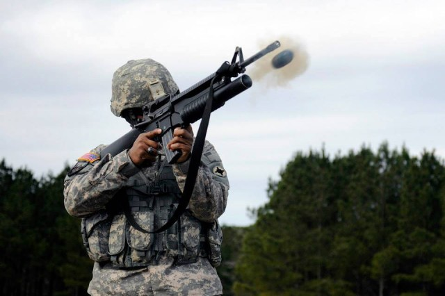 Staff Sgt. Nehemiah E. Taylor, of the Mississippi National Guard's 298th Support Battalion, fires the M203 grenade launcher during the individual weapons qualification weekend at Camp McCain, Miss.