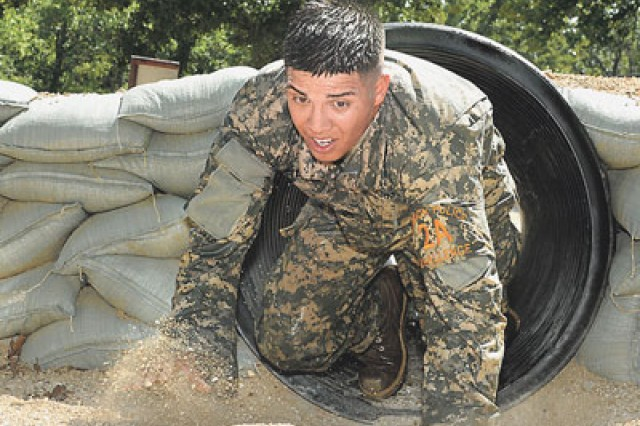 During the last event of day one, Staff Sgt. Roberto Castaneda pushes though the Physical Endurance Course.
