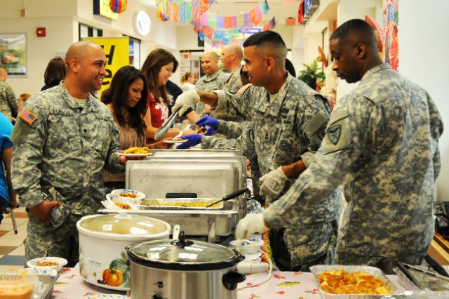 Soldiers serve up Hispanic cuisine during last year's Hispanic Heritage kickoff. This year's kickoff is Sept. 12, 11:30 a.m. to 1 p.m. at the AAFES Food Court.