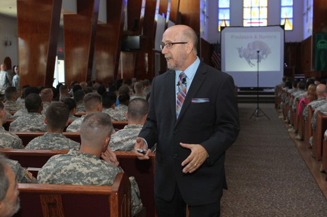 Russell Strand, chief of the Behavioral Sciences Educational and Training Division, U.S. Army Military Police School, talks to several of Camp Zama's senior leaders, Soldiers and Department of the Army Civilians about sexual harassment and assault in the workplace on Sept. 2 at the Camp Zama Community Club.  (U.S. Army photos by Yuichi Imada)