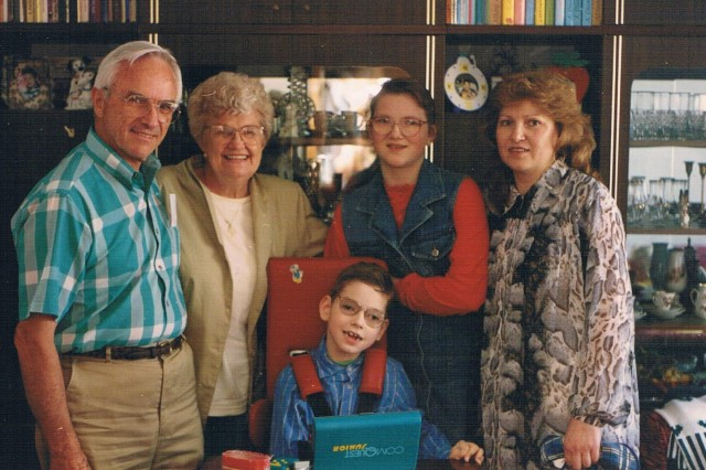 Fred Martin and his wife Valjean Young (left) of Atlanta, pose with Nerijus Gvergzdis (front), his sister Raminta and their mother Egidija at their apartment in Kaunas, Lithuania, circa 1996. Fred and Valjean, sponsored Nerijus, who was born with cerebral palsy, for multiple surgeries in the United States to have his legs uncrossed and his dental issues addressed. Almost 20 years later their grandson, 1st Lt. Andrew Martin of Nashville, Tennessee, 2nd platoon leader for Troop A, 1st Squadron, 91st Cavalry Regiment, 173rd Airborne Brigade, was deployed to Lithuania for Operation Atlantic Resolve and able to reconnect with Egidija and Nerijus for a brief reunion. The 173rd Airborne is currently deployed to Estonia, Latvia, Lithuania and Poland as part of Operation Atlantic Resolve, an exercise dedicated to demonstrating commitment to NATO obligations and maintaining interoperability with allied forces.