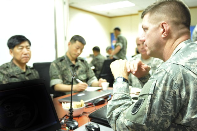 Maj. Gen. Tracy Thompson, commanding general, 412th Theater Engineer Command, and Brig. Gen. Joung Youn Kim, Assistant Chief of Staff/ Combined Forces Engineer, Combined Forces Command, discuss engineering training and support on the peninsula during an office call at Ulchi Freedom Guardian Exercise, Aug. 18, 2014 in Yongsan, Republic of Korea.  As the Army Reserve's theater engineer in the Pacific, the 412th deployed approximately 80 Soldiers to Korea, Japan and Hawaii to provide engineering expertise and other support functions during UFG and in support of mission requirements for Eighth Army, U.S. Forces Korea and U.S. Army Pacific.